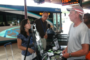 Juliana and Brandon talking with passengers at Grand Central about Greenlight Pinellas [Photo: Byron Boykins]