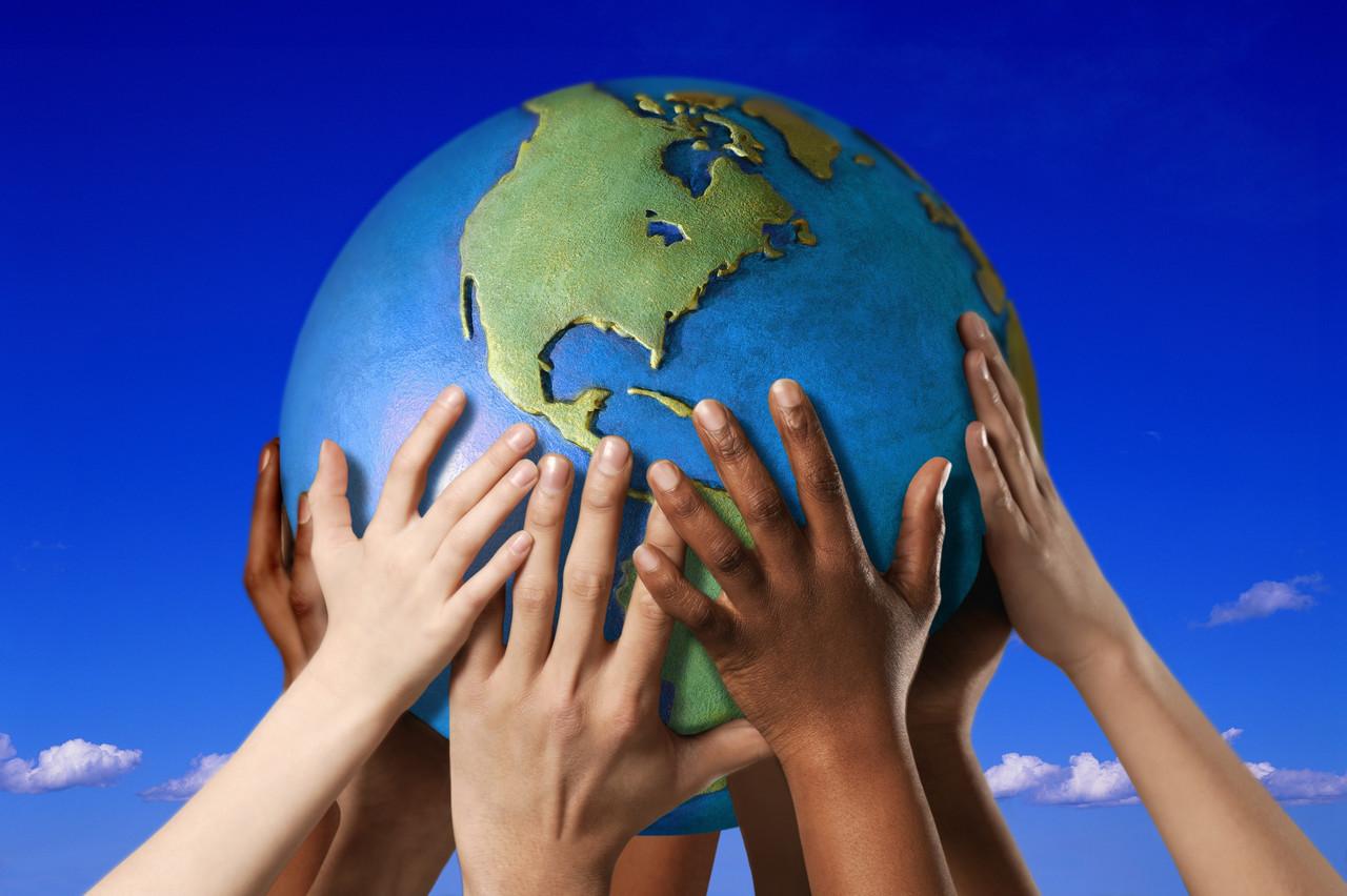 hands holding earth jpg